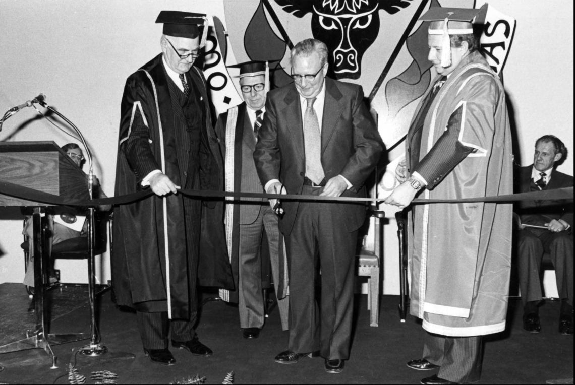 Carl O. Nickle cutting the ribbon to open the Nickle Arts Museum in 1978