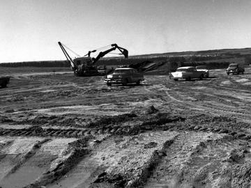 An excavator works to prepare the site for UCalgary's first buildings, now Admininstration and Science A, 1959.