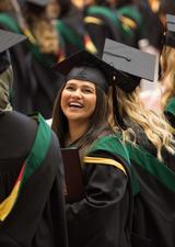 smiling student during UCalgary convocation ceremony